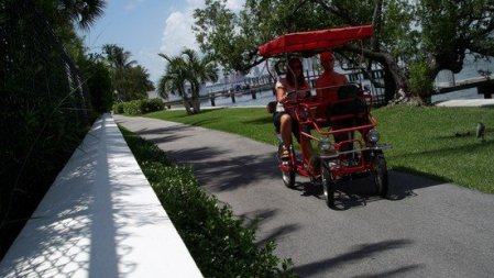 Star-troupers on a tandem bike in Palm Beach