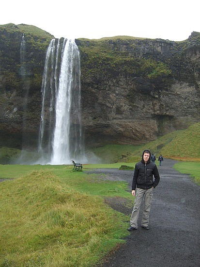Cariverga in front of a waterfall in Iceland