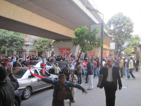People protesting the results of a soccer match in the streets of Cairo